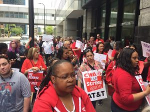 Workers strike AT&T - part of a wave of short grievance strikes
