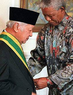 President Nelson Mandela awards neo-fascist dictator Mohamed Suharto for his donations to the ANC. Picture: The Telegraph