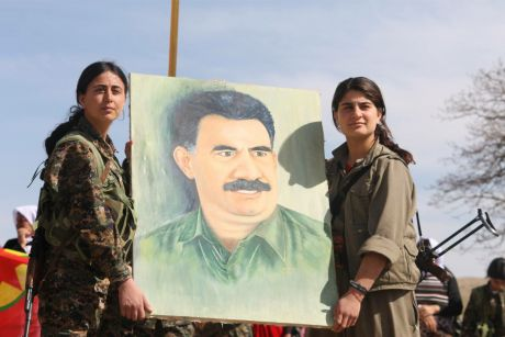 ybs_and_pkk_fighters_holding_up_a_painting_of_abdullah_calan.jpg