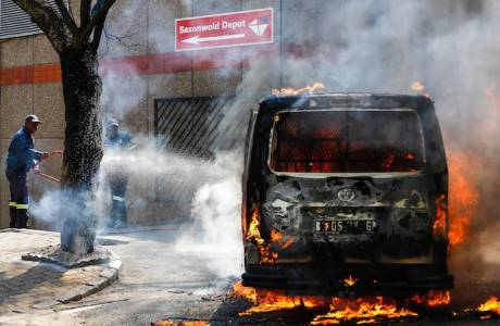 A Post Office van is set alight in Rosebank on September 2, 2014 in Johannesburg, South Africa. The Post Office recently announced it planned to fire 473 casual workers who had been on illegal strike. (Photo by Gallo Images / The Times / Moeletsi Mabe)